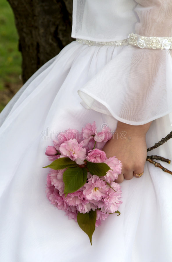 Holding Flowers. Flower girl holding pink flowers in hand stock photos