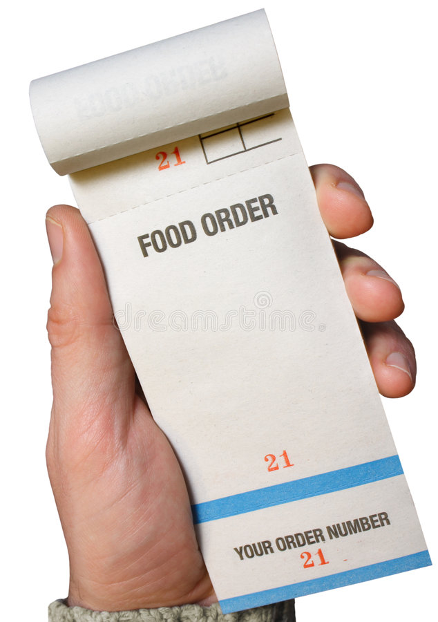 Holding a food order pad. Holding a food order pad, ready for the order stock photo