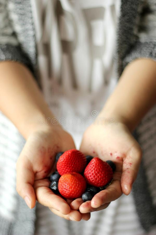 fresh strawberries and blueberries royalty free stock photo