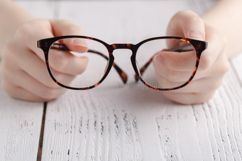 Holding glasses in female hands royalty free stock photo