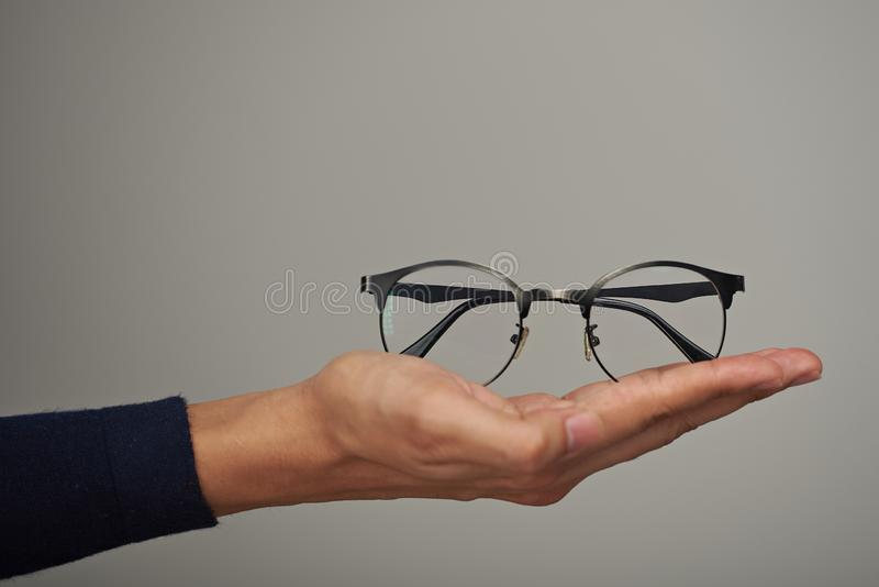 Holding glasses on hand palm stock photos