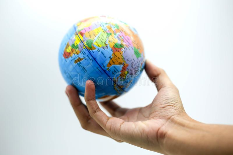 Holding globe world map on hands. stock images