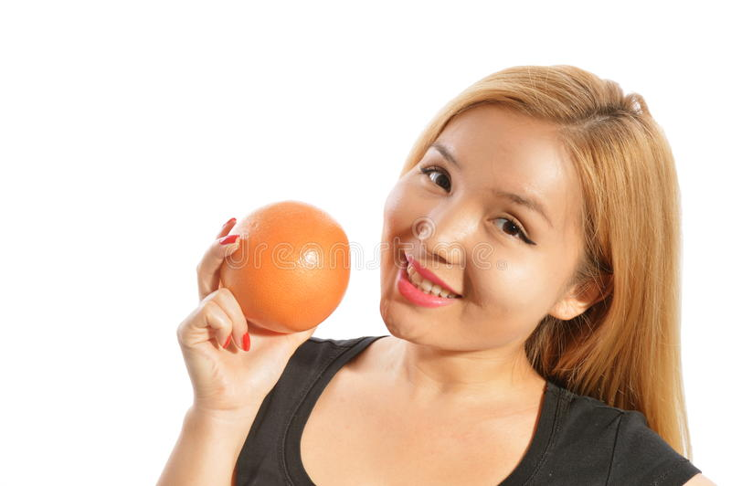 Holding Grapefruit stock images