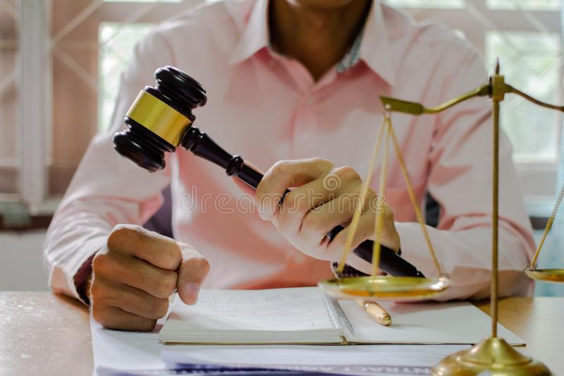 Holding Hammer law.Business man working on table. Lawyer Concepts .Selective Focus stock photos