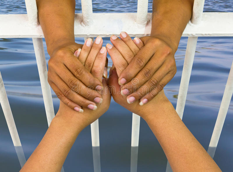 Holding The Hand Flooding Royalty Free Stock Image