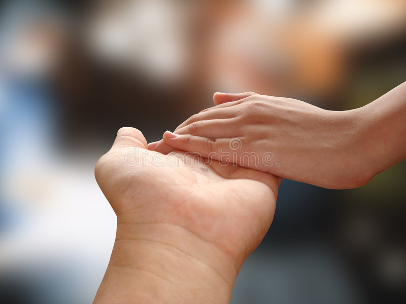 Holding Hands. Male and female holding hands royalty free stock photos