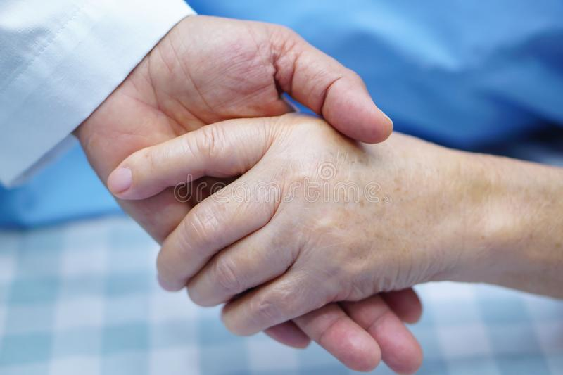 Holding hands Asian senior or elderly old lady woman patient with love, care, encourage and empathy. Holding hands Asian senior or elderly old lady woman royalty free stock photo