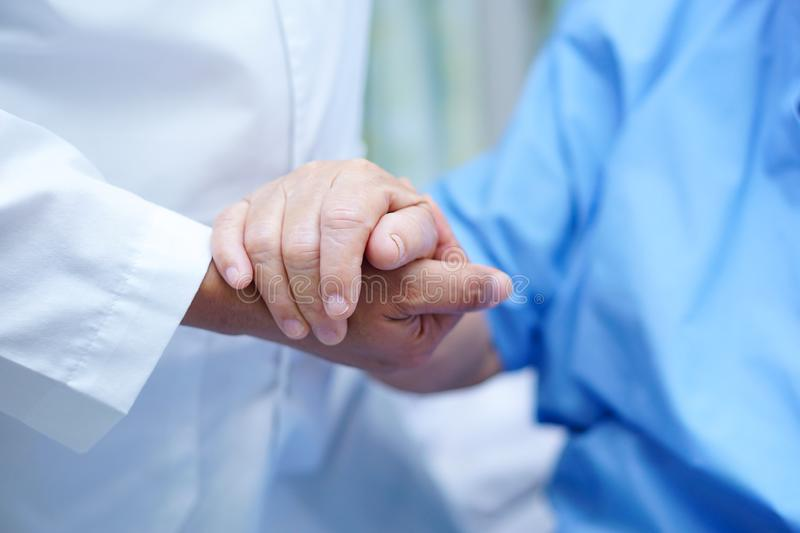 Holding hands Asian senior or elderly old lady woman patient with love, care, encourage and empathy at nursing hospital ward : hea. Lthy strong medical concept stock photos