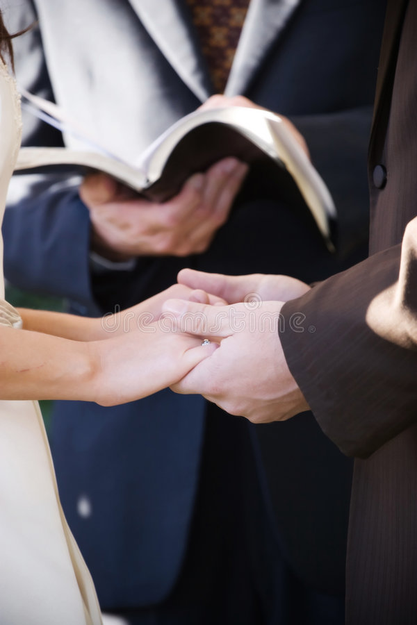Holding hands at the ceremony stock photography