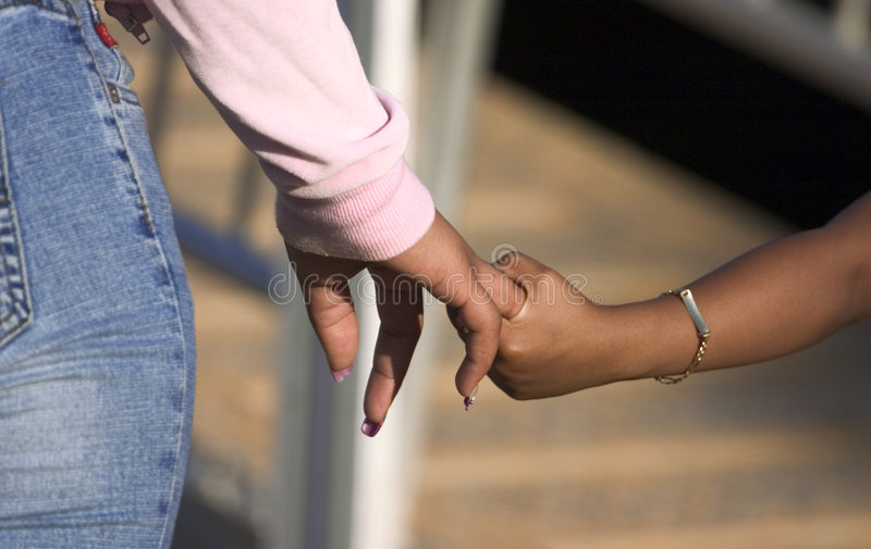 Holding hands (finger actualy) stock photos