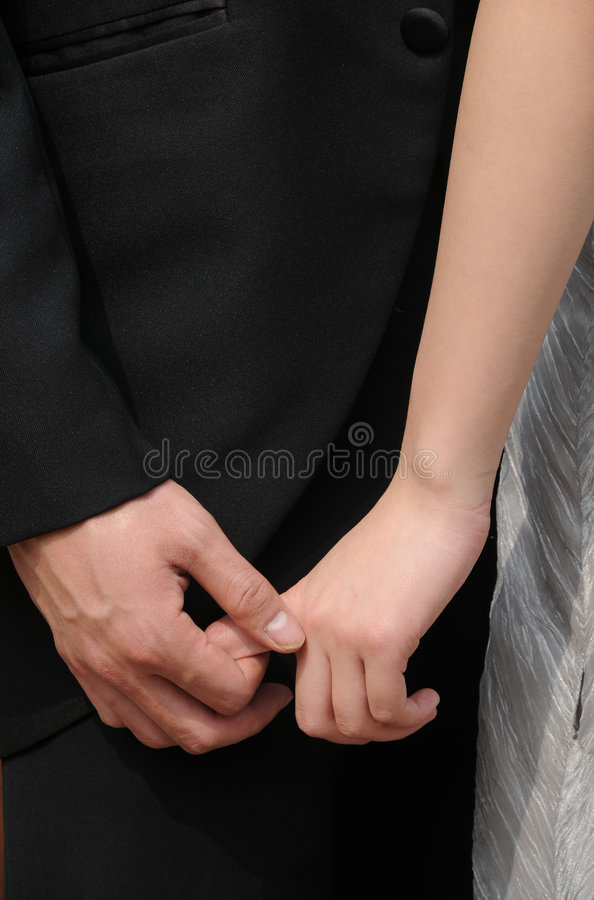 Holding hands lovers stock images