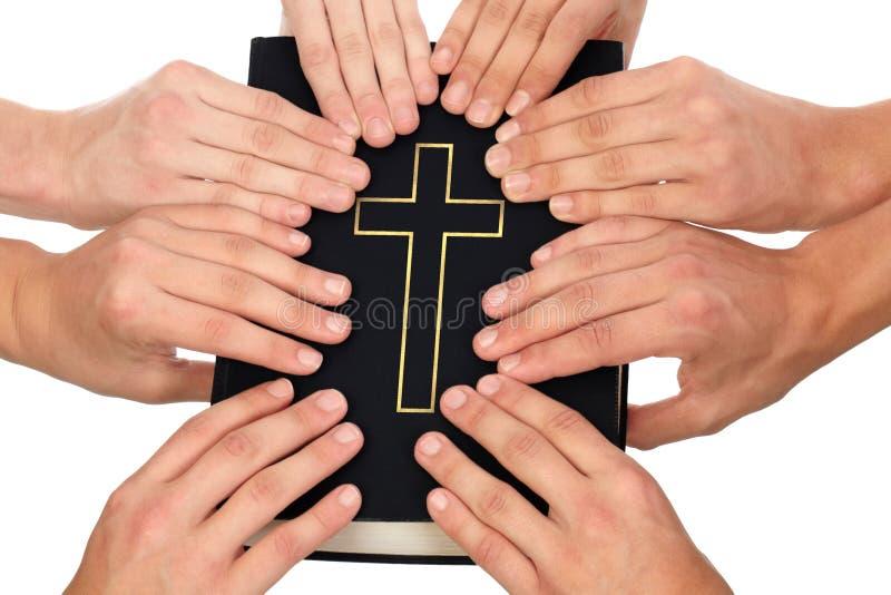 Holding Holy Bible stock image