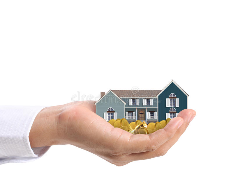 Holding house and coins stock photos