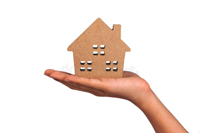 Holding house representing home ownership. royalty free stock photo