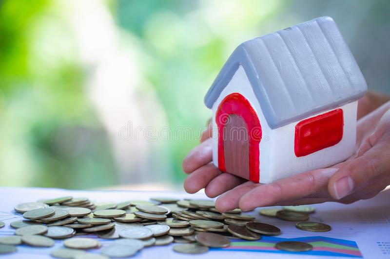 Holding house representing home ownership, mortgage, investment, real estate and property concept stock image