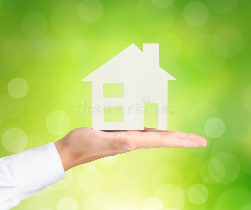 Holding house representing home ownership. And the Real Estate business stock photo