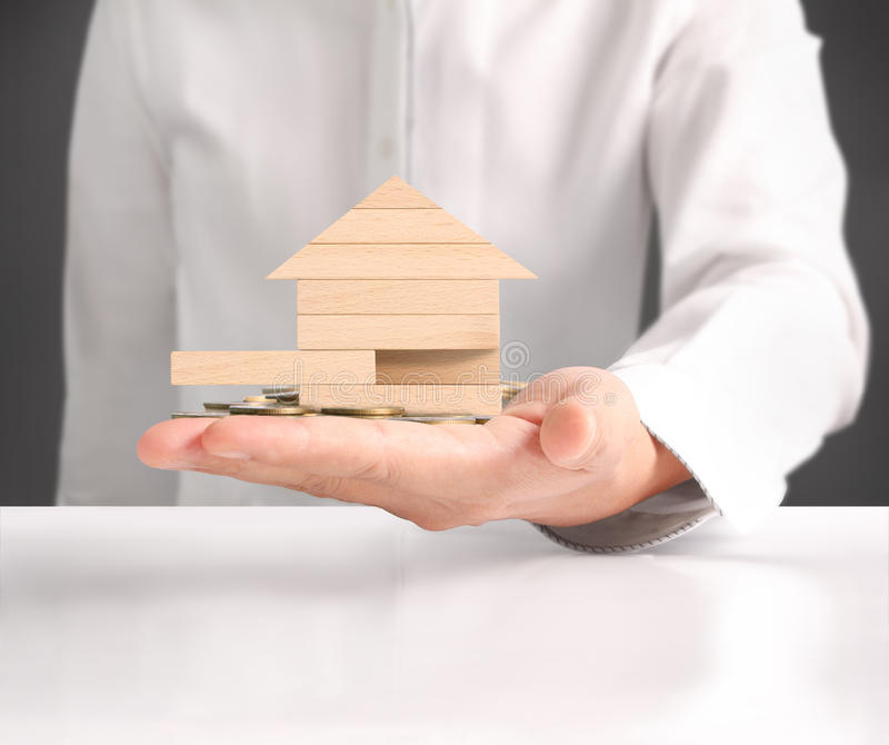 Holding house representing home ownership. And the Real Estate business royalty free stock photo