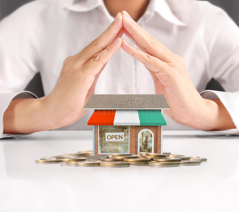 Holding house representing home ownership. And the Real Estate business stock photos