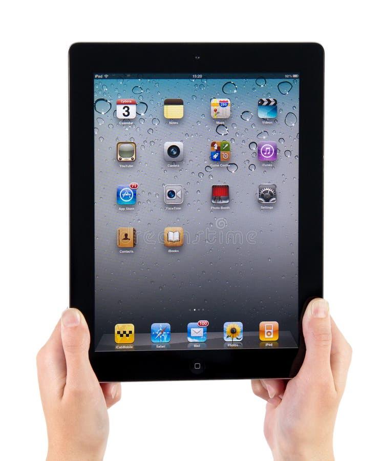 Holding iPad2 in Handen stock afbeeldingen