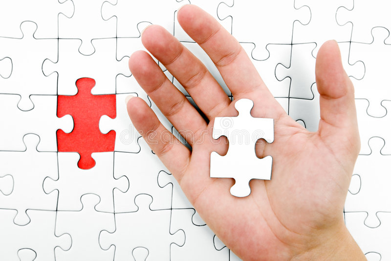Holding a Jigsaw Piece stock photo