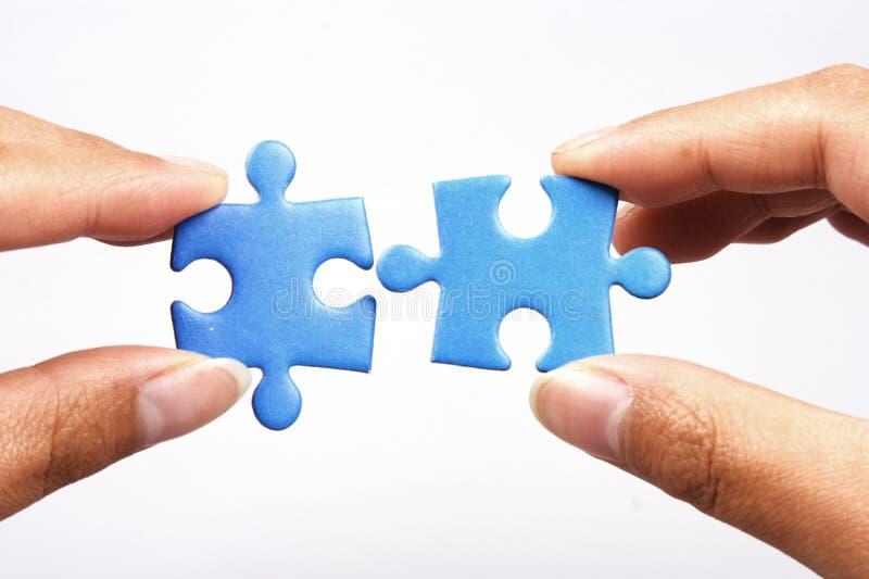 Holding Jigsaw Puzzle royalty free stock photo