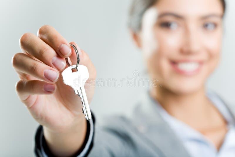 Holding key stock photo