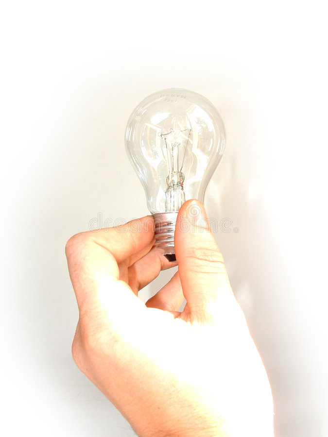 Holding a light bulb royalty free stock images