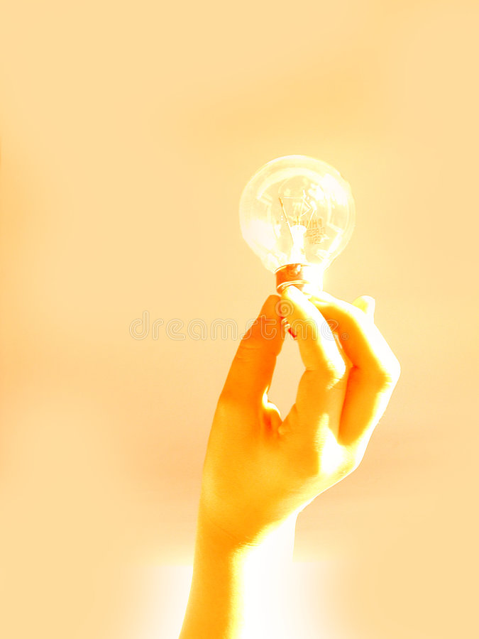 Holding a light bulb stock photos