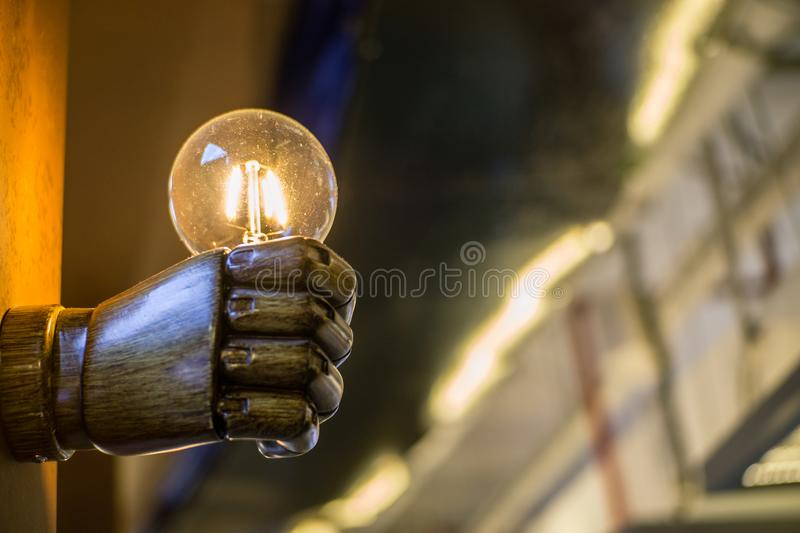 Holding a light bulb in one hand stock image