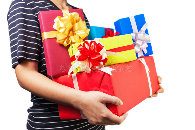 Holding a lot of Christmas/birthday/anniversaries gifts. Asian female holding a lot of Christmas/birthday/anniversaries gifts in her hands.The most beautiful stock image