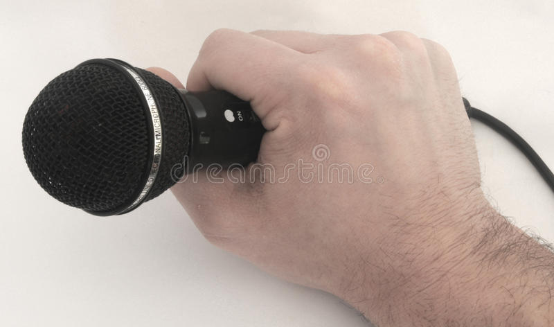 Holding microphone royalty free stock image