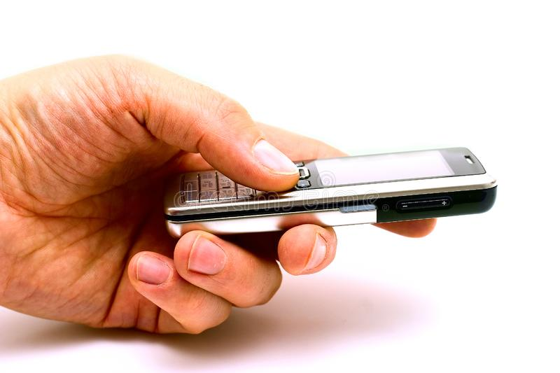 Holding the mobile phone royalty free stock image