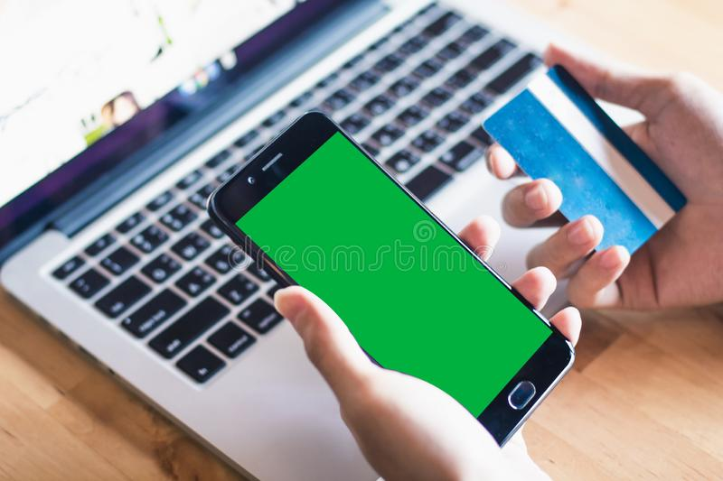Holding Mock-up Green with credit card. Bussiness concept royalty free stock photos