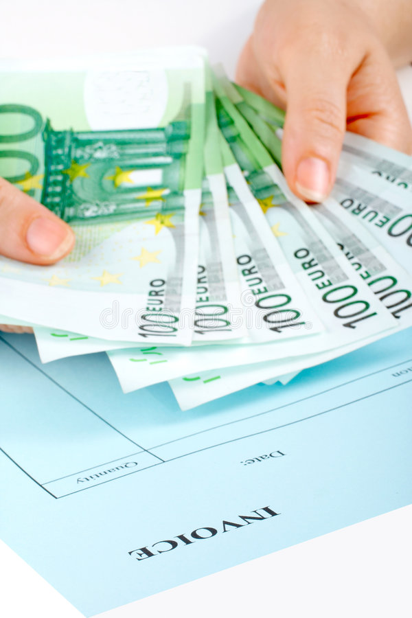 Holding money and invoice royalty free stock photos