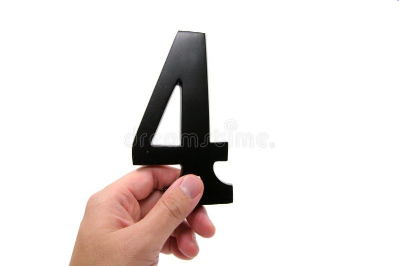 Holding numero 4 della mano fotografia stock