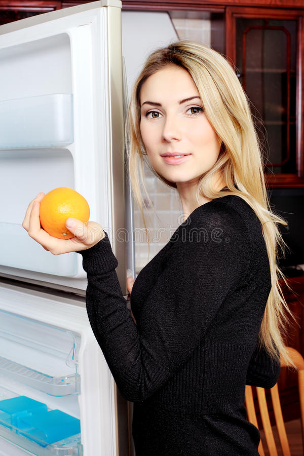 Holding orange stock photos