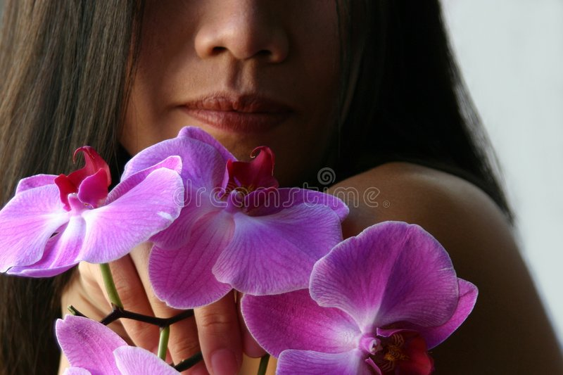 Holding orchids royalty free stock image