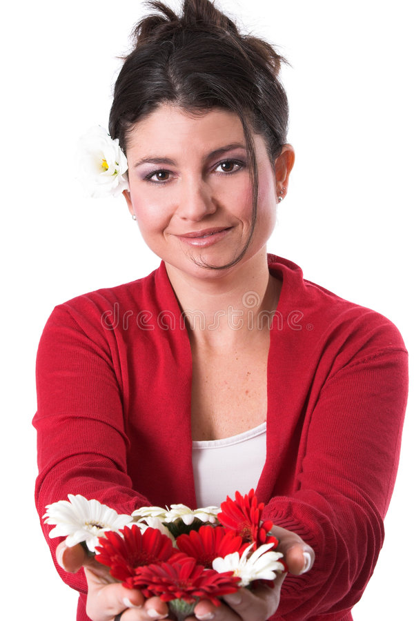 Holding out flowers stock image