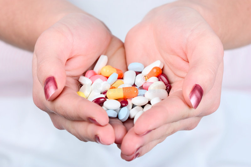 Download Holding out pills stock image. Image of horizontal, hand - 1717387