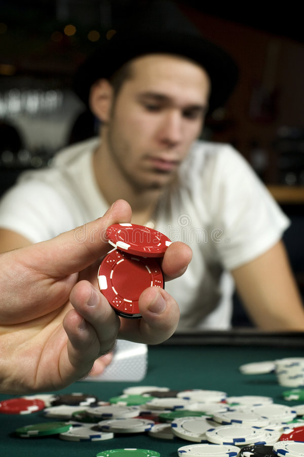 Holding poker chips royalty free stock photography