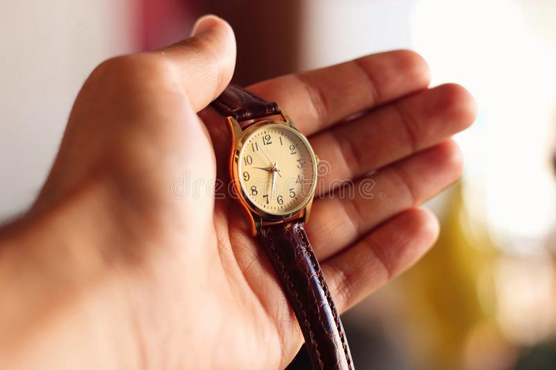 Holding a quartz watch. royalty free stock photo