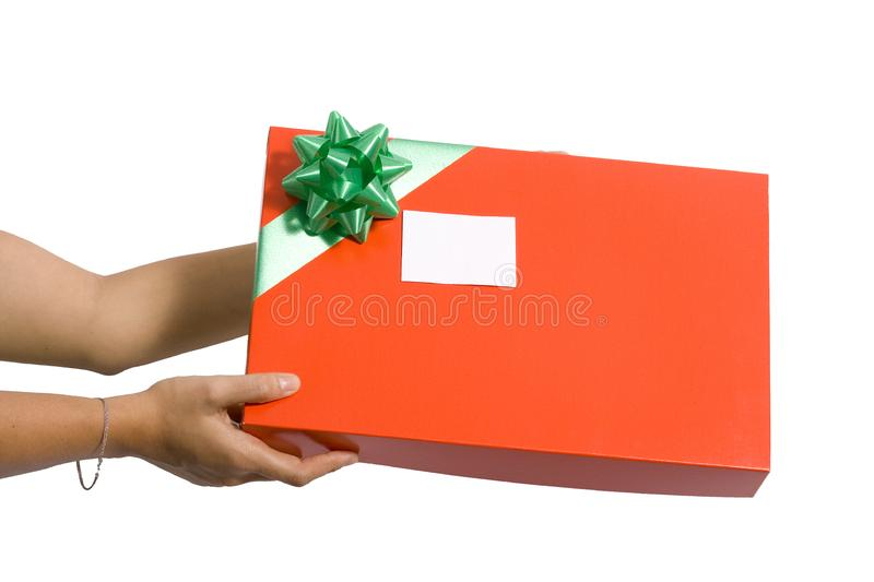Holding a red gift box royalty free stock photo