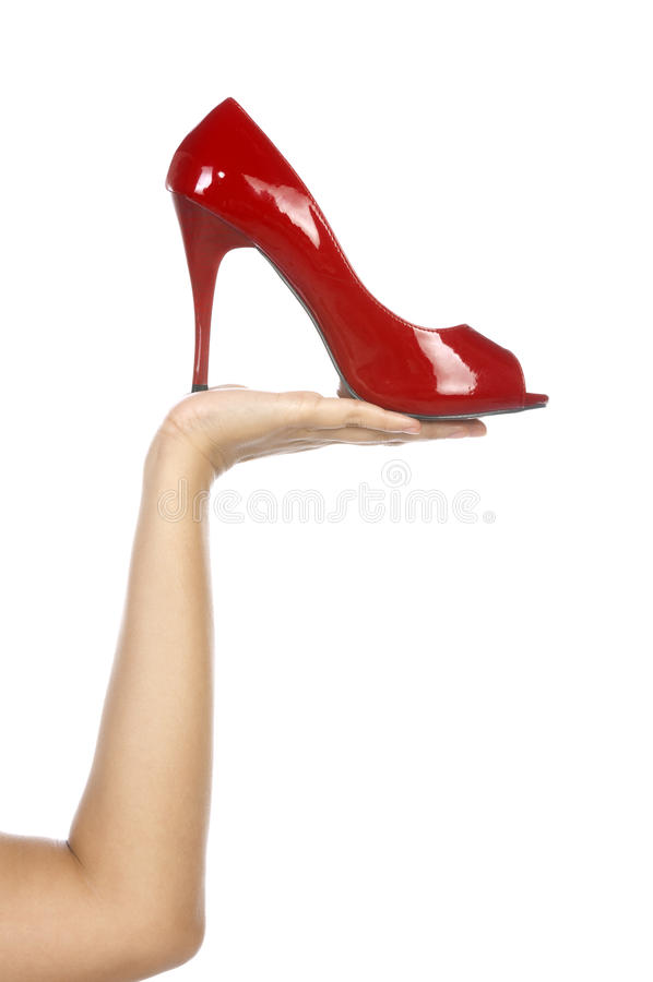 Holding Red Shoe stock image