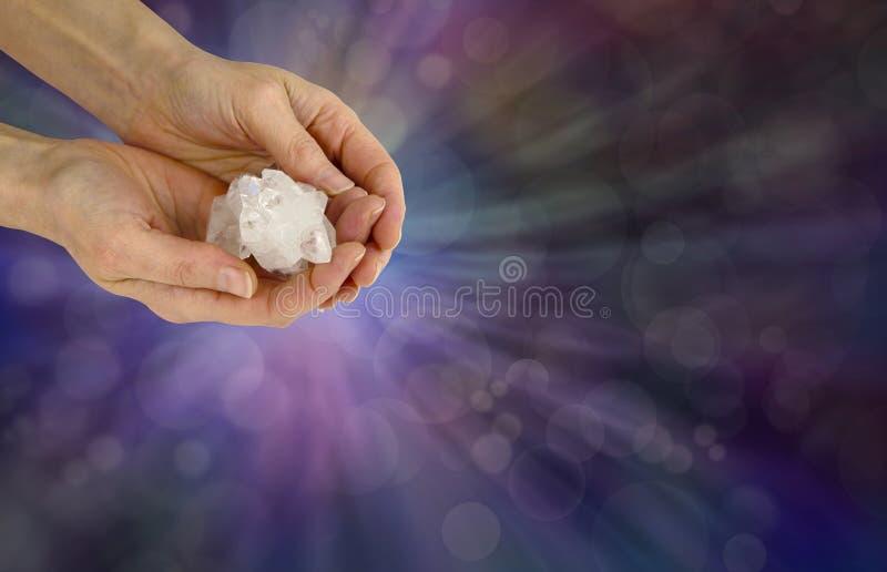 Holding a Reiki Master Apophyllite Crystal Cluster stock images