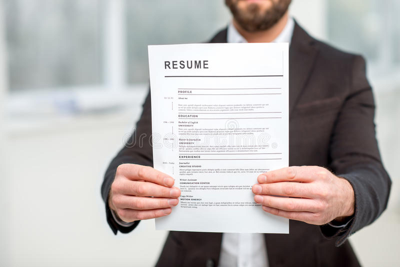 Holding resume paper royalty free stock image
