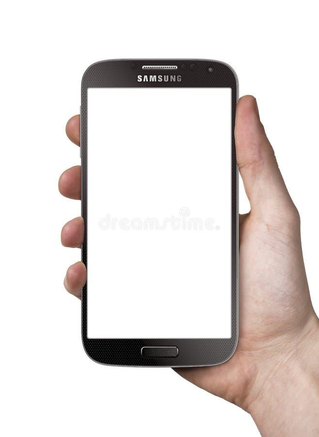 Holding Samsung Galaxy S4 black stock image