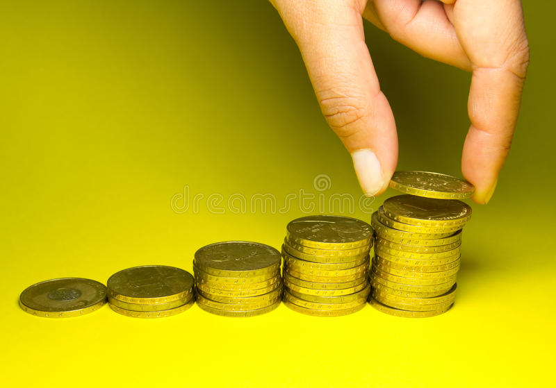 Download Holding Savings Of Gold Coins Stock Image - Image: 14700929