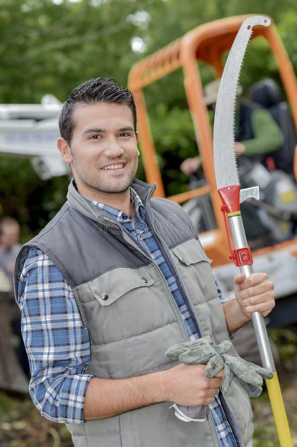 Holding sharp gardening tool stock photos