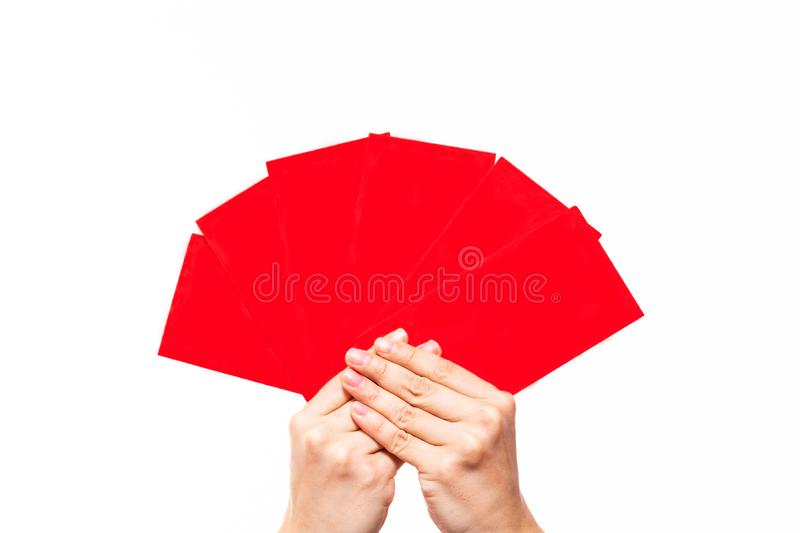 Holding six red envelopes, isolated on white background. Red envelopes use for putting money to envelope and give to children or stock photography