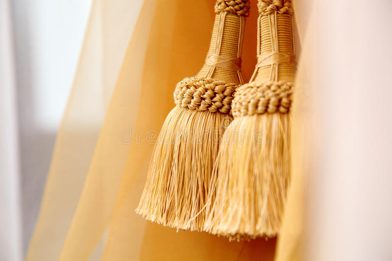 Holding strap for a curtain. With brushes close up stock photography